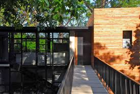 black iron railings bridge modern house design with glass window