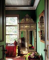 gypsy decorating style with armoire and mirror and area rug and