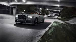 roll royce dawn black rolls royce dawn muscles up with widebody and more power