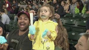 Yellow Raincoat Girl Meme - little girl loses her mind over her cotton candy at seattle mariners