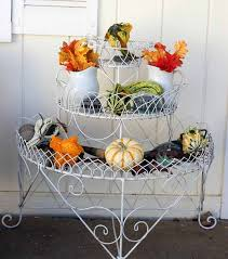 fall porch with pumpkins mums and vintage furniture for halloween