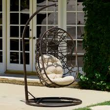 Rattan Swinging Chair Dark Brown Rattan Hanging Swing Chair With White Cushion And Round
