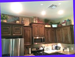 ideas for tops of kitchen cabinets top of kitchen cabinet decor ideas beautyconcierge me