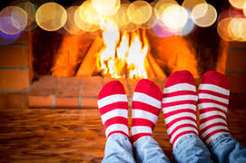 new years socks family in christmas socks near fireplace and baby