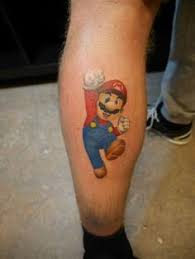 this mario bros video game tattoo was done by elmo from