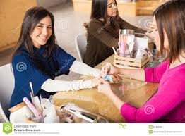 beautiful woman getting her nails done stock photo image 65445715