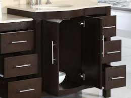 bathroom sink black polished iron double tap faucet above white