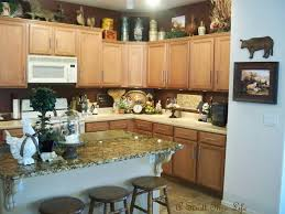 Kitchen Decorating Ideas Above Cabinets by Kitchen Cabinets Top Decorating Ideas