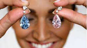 pink diamond earrings sotheby s sells pink and blue diamond earrings for record us 51