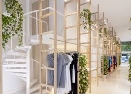 clothes hang from wooden ladders in mit mat mama store wooden