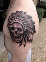 black and grey skull and headdress tattoo by david mushaney