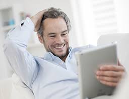 man using his tablet