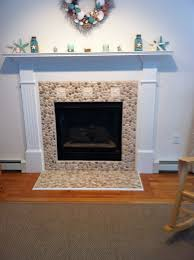 Unused Fireplace Ideas Java Tan And White Pebble Tile Pebble Tiles Beach Cottages And