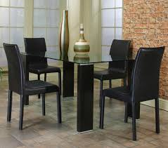 simple glass top dining table with four black wooden legs mixed