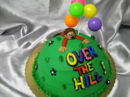 one cake that has a man trying to climb over the hill and the