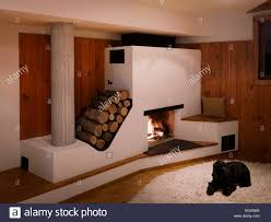 fireplace with log storage in wood panelled living room uk home