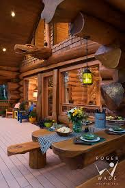 log home photographer cabin images log home photos log cabin stock photo twilight view of deck with built in dining table set for