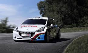 peugeot cars 2013 peugeot returning to pikes peak in 2013 with nine time wrc champ