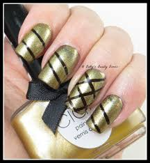 purple and gold striping tape nail art lazy betty