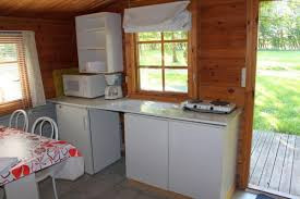 log cabin with terrace equipped with kitchen with cabinets bunk