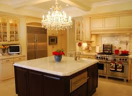 kitchen island chandelier kitchen furnished with wood cabinets and using