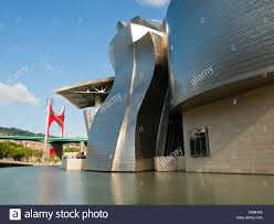 view of the guggenheim museum bilbao bridge and public art by the