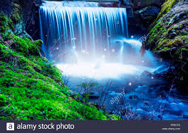 magic river scenery with waterfall and lights fairytale waterfall