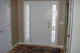 black painted solid wood front door using one way vision glass