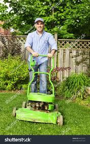 man lawn mower landscaped backyard stock photo 59123731 shutterstock