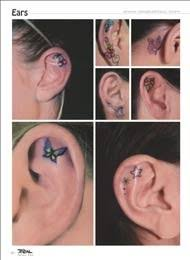 small butterfly and ear tattoos