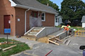 pouring concrete in stillman valley at the red brick church the