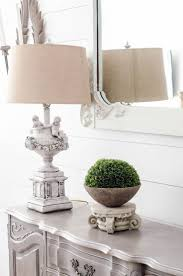 decorating table lamp with tan white floral shade and tan ceramic