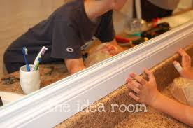 framing bathroom mirror with molding diy mirror baseboard molding bathroom mirrors and baseboard