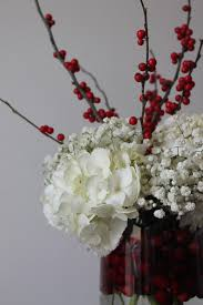 christmas wedding ideas cranberries in clear hurricane candle