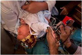 previous pinner a coptic christian baby gets a cross tattooed on