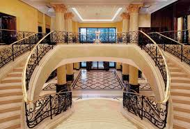 incridible luxury staircase design with handcrafted iron banister