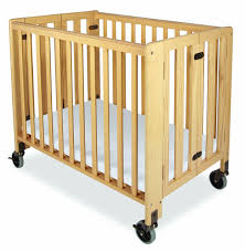 Natural Wood Convertible Crib by Amazon Com Foundations Hideaway Compact Sized Folding Crib