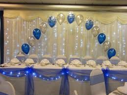 make a beautiful head table with swags and bows with lights get