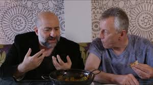cuisine tv programme omid djallili the comedian enjoying his balti for tv programme