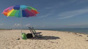 Beach Umbrella And Chairs Sailboats Beach Chairs And Umbrella Scene Stock Footage