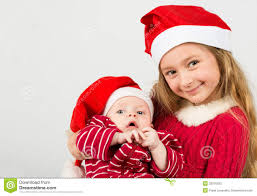 santa claus costume for toddlers stand in santa claus hats and holding baby boy stock photos