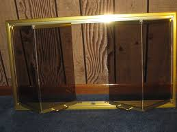 Polished Brass Fireplace Doors by Thermo Rite Z Fireplace Bi Fold Door Bronze Glass Polished Brass