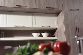 Horizontal Kitchen Cabinets Warm And Inviting Contemporary Kitchen Textured Foil Cabinets
