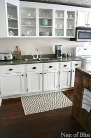 Laminate Flooring Kitchen by Hardwood Laminate Flooring For Kitchen White Cabinets Hardwood