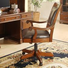 riverside bristol court executive desk caster equipped wooden desk chair with leather covered seat by