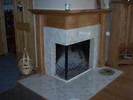Fireplace Tile Design Ideas by Corner Two Sided Fireplace Mantels Corner Fireplaces Big Tiles