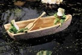 ornaments frogs in a boat floater