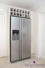 american style fridge freezer with surrounding gloss cream units in