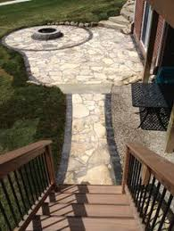 canadian flagstone patio with unilock paver accent bricks by