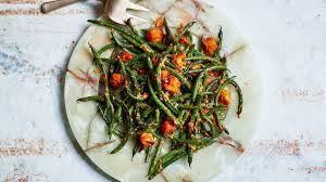 blistered green beans with tomato almond pesto recipe bon appetit
